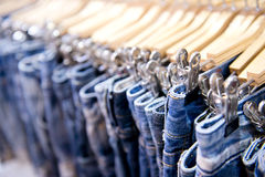 Jeans hanging on rack Royalty Free Stock Photos