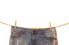 Jeans hanging on a rope clothesline Stock Images