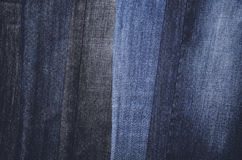 Jeans hanging vertically on a hanger. full frame. horizontal Royalty Free Stock Photo