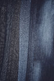 Jeans hanging vertically on a hanger. full frame. vertical Stock Photo