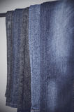 Jeans hanging vertically on a hanger. vertical Royalty Free Stock Photo