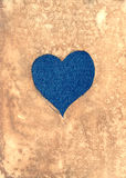 Jeans heart under the aged paper Stock Images