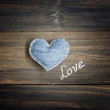 Jeans heart on wooden background Royalty Free Stock Images