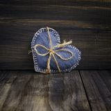Jeans heart on wooden background Royalty Free Stock Photos