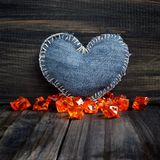 Jeans heart on wooden background Stock Images