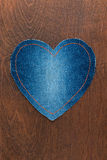 Jeans heart on wooden background Stock Photos