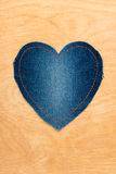 Jeans heart on wooden background Stock Photography