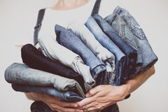 Jeans in her hands royalty free stock photography