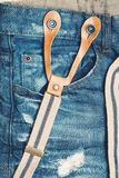 Jeans with holes specially created aged and suspenders Stock Photos