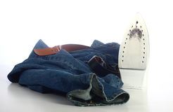 Jeans and an Iron. A shot of jeans and an iron Royalty Free Stock Photo
