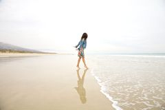 Jeans jacket woman touching sea Royalty Free Stock Images