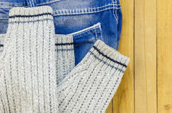 Jeans and knitted sweater on the boards Royalty Free Stock Photography