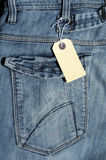 Jeans and Label. Photograph of a back pocket of a pair of jeans with a blank label Stock Photos