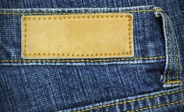 Jeans label sewed on a blue jeans Stock Photography