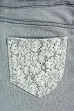 Jeans with lace pocket Royalty Free Stock Photo