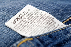 Jeans laundry care label. Selective focus royalty free stock image