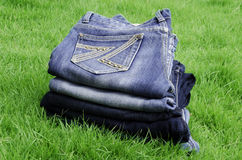 Jeans lawn. Jeans background with a green grass Royalty Free Stock Images