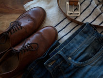 Jeans and leather. Everyday clothing of a modern man Stock Photos