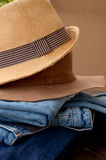 Jeans and Leather Hat. Fashion Torn Jeans and Leather Hat stock photography