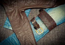 Jeans, leather jacket and a belt with a buckle Stock Photos