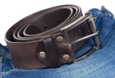 Jeans and leather strap. Stock Photos