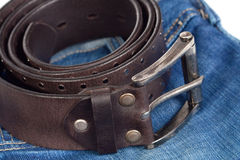 Jeans and leather strap. Stock Photography