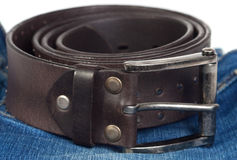 Jeans and leather strap. Royalty Free Stock Photography