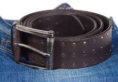 Jeans and leather strap. Royalty Free Stock Image