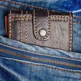 Jeans with a leather wallet on its pocket Stock Photography