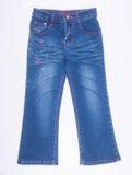 jeans of leuke jeans voor jonge geitjes op een achtergrond Stock Foto