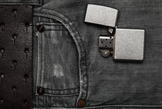 Jeans and a lighter. Flat top view. Stock Images