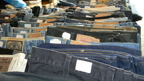 Blue Jeans. Line of blue jeans ready for sale in Totnes open air market Royalty Free Stock Image
