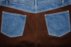 Jeans and lined brown fabric textures Royalty Free Stock Photo