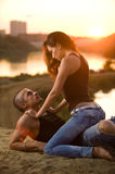 Jeans Love. Pair in jeans on a sunset royalty free stock photography