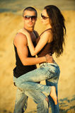 Jeans love. Young couple on a beach Royalty Free Stock Images