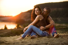 Jeans love. Pair in jeans on a sunset royalty free stock photo