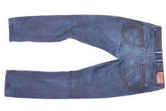 Stylish jeans lie on isolated white background Stock Image