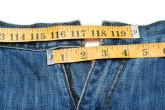 jeans mäter bandet royaltyfri fotografi