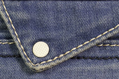 Jeans. Macro ringblue jeans with a white button of Stock Images