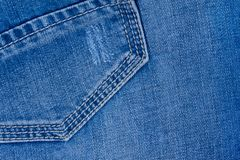 Jeans material with a rough texture blue color. Rear pocket jeans. Modern lifestyle stock photography