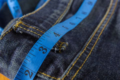 Jeans with measure tape Stock Image