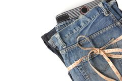 Jeans with measure tape Royalty Free Stock Photography