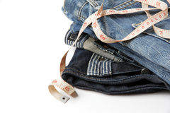 Jeans with measure tape Stock Photo