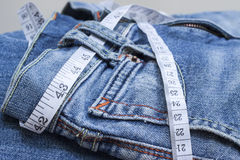 Jeans and measuring tape Stock Photos