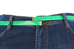 Jeans and measuring tape - slimming concept Royalty Free Stock Image