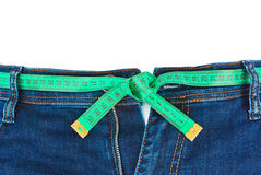 Jeans and measuring tape - slimming concept Stock Images