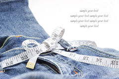 Jeans and measuring tape Stock Image
