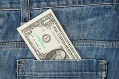 Jeans med amerikan 1 dollar räkning Arkivbild