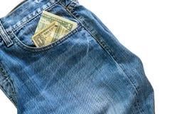 Jeans med den amerikanska dollarräkningen på dess fack Royaltyfri Foto