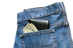 Jeans med den amerikanska dollarräkningen på dess fack Royaltyfri Bild